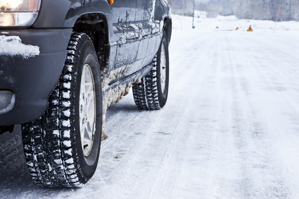 cars tires on a snowy road