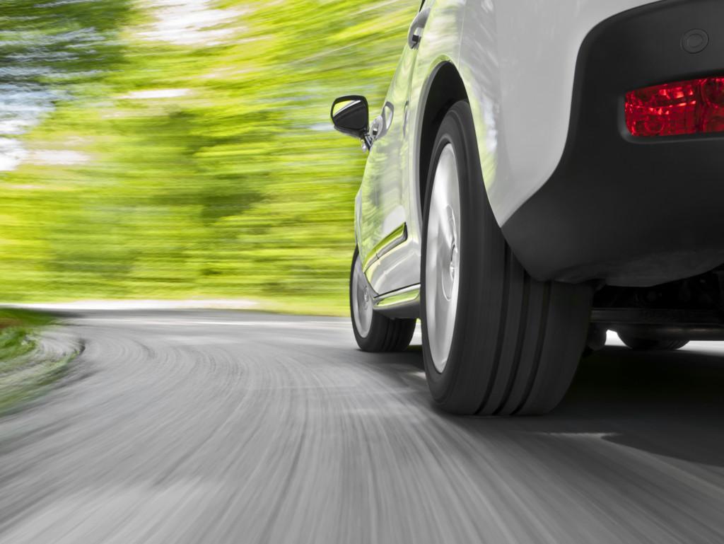 car speeding on a road